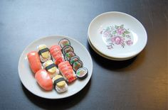 This is a complete sushi dinner for two dolls. This listing includes: 2 pieces of ebi (shrimp) sushi 6 slices of sushi roll 2 pieces of sake (salmon) sushi 3 tamago (egg sushi) 1 large serving platter 8.5 cm wide 2 dinner plates 7.4 cm wide  The ceramic plates are vintage toys. They have been played with and do show imperfections consistent with their age. My dolls, furniture accessories or other food items are not included. Each item is meticulously sculpted in a smoke free, pet friendly…