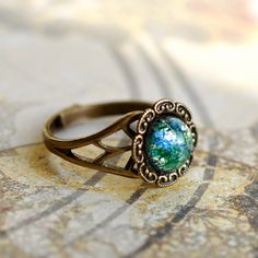 Green Glass Fire Opal Ring. Vintage glass on brass. via Etsy.