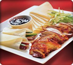 The Chinese People have perfected the art of slow roasting duck, and turned it into a staple of Chinese cuisine. Fine Chinese Dining Peking Duck, or Beijing Roast Duck is a famous item of Chinese cuisine. This duck dish has been prepared since. Duck Recipes, Asian Recipes, Gourmet Recipes, Cooking Recipes, Ethnic Recipes, Peking Duck Pancakes, Roast Duck, Chinese Restaurant, Asian Cooking