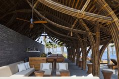 Naman Retreat Beach Bar was completed recently by Vo Trong Nghia Architects. The bar has an area of 143 sqm and is located in Naman resort. Bamboo Roof, Bamboo House, Bungalows, Bamboo Restaurant, Bamboo Building, Green Building, Natural Building, Bamboo Structure, Bamboo Construction