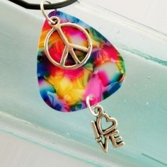 Rainbow tie-dye with peace sign guitar pick as a pendant. #susanwilliamsdesigns on Etsy #dteam