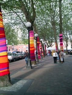 """""""Yarnbombing"""" knit graffiti, I love it. I wish someone would knit prettyness like this all over Sioux City."""