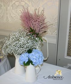Rustic jug gypsophilla hydrangea table centerpiece   http://www.ambiencevenuestyling.com/wedding-stylists/reading/