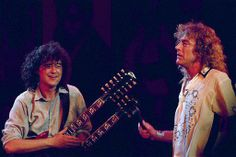 Former Led Zeppelin band members Jimmy Page, left, and Robert Plant perform at the Atlantic Records 40th anniversary celebration. The marathon show featured artists from the recording label's early years to the latest pop stars.