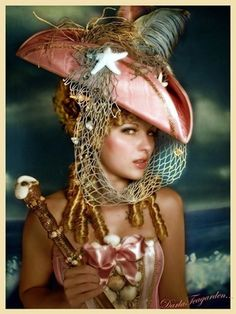 Of course, pirate queens have pink hats with nets.  Of course.