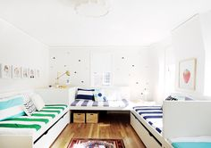 This modern room with trundle beds sleeps SEVEN. Great sleepover space at Grandma + Grandpa's house.