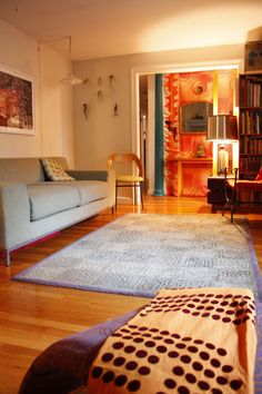 Warm Rooms; This room shows warm colors with its uses of oranges and yellows. The white walls and blue couches make the oranges feel even brighter.