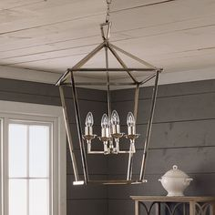 The open design of this light prevents it from overwhelming the room. #oka #boathouse #canada #inspiration #diningroom