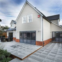 Light grey timber clad house with dark grey bi-fold doors. Modern new build, building a house with Potton, Self Build Specialists. Wood Cladding Exterior, House Cladding, Facade House, Cladding Ideas, Timber Frame Homes, Timber House, Design Your Dream House, House Design, House Extension Design