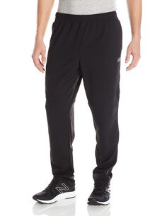 New Balance Men's Slim Performance Pants, Medium, Black. Premium wicking fabric has smart technology that provides proactive thermo-regulation and superior moisture management. Internal drawcord. NB DRY is a moisture wicking fabric that helps release moisture away from the body. Fabric is also fast drying.