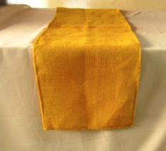 "Burlap Table Runner 12 Inches X 90 Inches - Mustard Yellow by ArtOFabric. $8.99. This table runner is a long, narrow piece made of 100% jute burlap that measures 12"" X 90"" and it is made to be placed lengthwise or horizontally on the table.The Burlap tablecloth's simplicity and utility make it a year round favorite"