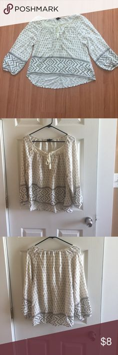 Forever 21 size Large gorgeous Boho print blouse. Super cute, light, bohemian style printed Forever 21 shirt size large. The neckline has a cute knitted pattern that ties in the middle, which adds great detail to this top. I love this top because it's really lightweight, comfortable, and in style. The fabric and print are in really good condition and show little to no wear! Great buy! Forever 21 Tops Blouses