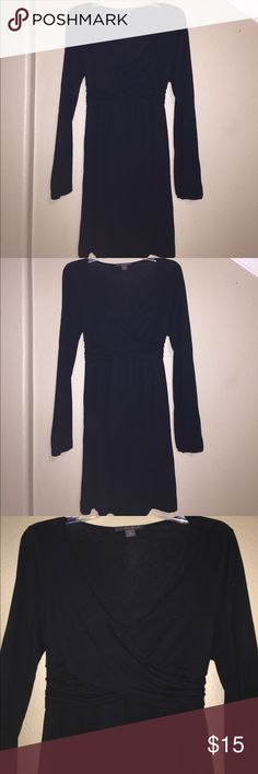 Black Dress Black scoop neck dress with a crossover design on the chest . Has cute detailing at the waist and a tie to be tied in the back or front . Cute with tights and botties or heels . Forever 21 Dresses Long Sleeve
