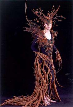 "The inspiration for ""Perelandra"" came from the natural environment, the roots of trees and autumn leaves illuminated by the last rays of twilight.    ""Perelandra"" was crafted from Recycled Copper Wire, Glass Beads, with roots made of Tissue Paper Rope, bound with wire and adorned with glass beads."