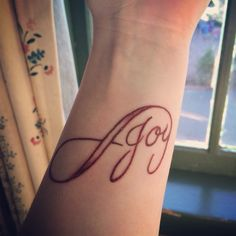 Be happy. Daily reminder. Forever joy. Infinity tattoo. Wrist just below just slanted just the turn of my arm. No black but brown. The colour of the earth. Be joy.