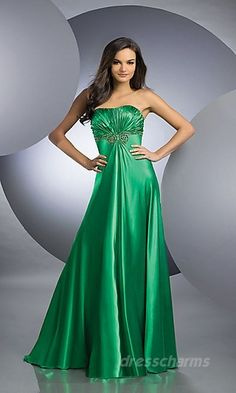 This dress is emerald green which would be for a spring tone. This is tight in the bust and loose in the skirt for a triangle shape. The sweet heart neck line shows femininity. Finally, this is a smooth, shiny texture which makes the person look bigger and curvier.