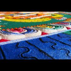 Close up detail of the Medicine Buddha mandala sand painting at Drepung Loseling Monastery in Atlanta GA.