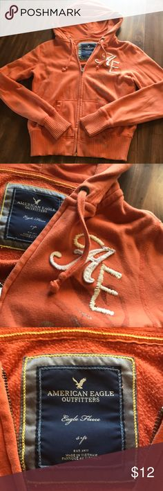American Eagle Orange small zipup hoodie American Eagle Orange small zipup hoodie, worn a few times. Super comfy American Eagle Outfitters Tops Sweatshirts & Hoodies