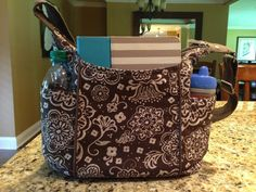 Brown woodblock floral free to be carryall purse, new for Fall 2013. www.mythirtyone.com/annapayne