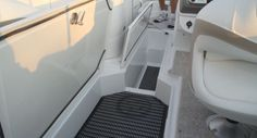 Cruisers Yachts 238 Bow Rider: The 238 has storage lockers with mat liners below the deck.