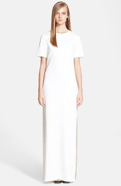 """Free shipping and returns on Alexander McQueen Crepe Gown at Nordstrom.com. <p><B STYLE=""""COLOR:#990000"""">Pre-order this style from the Pre-Spring 2015 collection! Limited quantities. Ships as soon as available. You'll be charged only when your item ships.</b></P><br>A clean, minimalist aesthetic defines this figure-skimming crewneck gown cut from a column of fine optic-white crepe and eased by sky-high side slits."""
