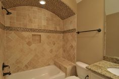 Step away from the ordinary white bathroom tile, and move towards your own mosaic style.