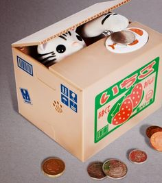 While the lid is closed, place a coin on top of the white plate. Watch as the lid opens to reveal the sly kitty who peeks out, then snatches the coin with his paw! Mechanical bank makes saving fun for kids and adults. Access coins from bottom. Objet Wtf, By Any Means Necessary, Little Kitty, Gadget Gifts, Secret Santa Gifts, Money Box, Tech Gifts, Stocking Fillers, Tech Gadgets