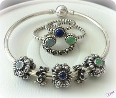 Pandora rings and bangle with charms. (A sweet Mother's Bracelet and ring stack! ~PANDORA MOA)