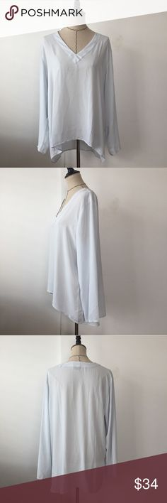 Ann Taylor light blue v neck blouse Great blouse for everyday use it for work! Dress it up or down. V neck in the front. 100% polyester. Great condition. Firm. Ann Taylor Tops Blouses