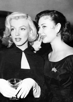 Marilyn Monroe and Mitzi Gaynor (with Ms. Gaynor's natural hair color) at columnist Sheila Graham's wedding (February 14, 1953)