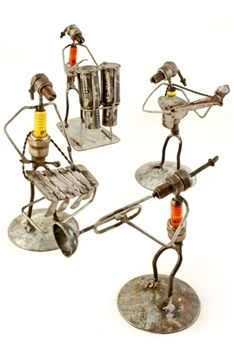 Members of a fair trade cooperative in Burkina Faso, West Africa, assemble this unique bongo player from metal scraps and recycled spark plu...