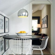Bertoia chairs, Arco lamp. I really like how the lamp arches over the path from the doorway.