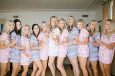 bridesmaids in matching floral pajamas holding champagne http://itgirlweddings.com/10-movies-to-watch-with-your-bridesmaids/