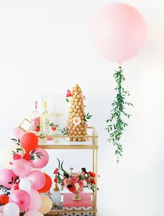 Bridal shower decor idea - bridal shower bar cart with desserts, drinks + pink balloons {Courtesy of Best Friends For Frosting}