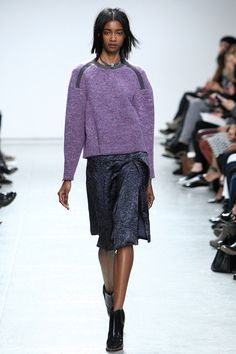 Big sweaters over all sizes of skirts seems to be in for fall 2014. And purple! Yes!