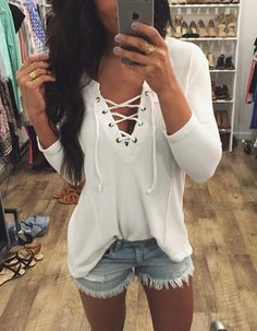 Great white laced up top with denim shorts
