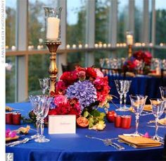 fusia and royal blue wedding | Royal blue lamour linens covered the reception tables, which were ...