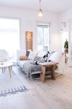 White Scandinavian living room with wide wood planks on the floor, white sofa and graphic cushions - Daily Home Decorations Living Room Interior, Home Living Room, Home Interior Design, Living Room Decor, Dining Room, Beautiful Living Rooms, Dream Decor, Decoration, Home Furniture