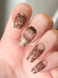 Brown henna tattoo nail art