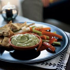 "100-Calorie Snacks     Avocado-Yogurt Dip with Cumin  Heart-healthy guacamole is delicious, but if you want a spin on the same-old same-old, pull out this little overachiever. The yogurt gives it a light, fluffy texture, while cumin adds a bit of zing. Dive in with some sliced bell peppers and come up from this snack saying, ""Yum!"""