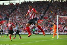 Graziano Pelle (centre) jumps for joy after opening the scoring for Southampton in their 4...