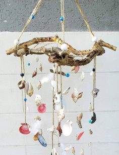 Check out this item in my Etsy shop https://www.etsy.com/uk/listing/470962263/driftwood-sea-shell-wind-chime-boho