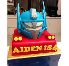 Step by step Optimus Prime head cake tutorial. Lizzie as a Mummy: Aiden's 4th Transformers Birthday