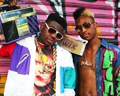 Hiphop culture (born in 1973 in Bronx), including music, dance, graffiti and fashion, started to become popular in the African-American community in 1980s. These are hiphop guys wearing funky colourful outfits with graffiti prints, crazy hairstyle, earrings, sunglasses and always carry a boombox.
