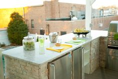 A bar - stocked with a refrigerator, ice maker, and tap - complete this outdoor kitchen. #CousinsOnCall