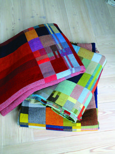 Wallace Sewell - These throws are a new addition to the Wallace Sewell collection. 100% Wool with graphic blocks of colour and on the reverse is a different combination of colours.