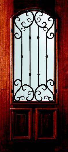 Beautiful eyebrow arch top double wrought iron door with for Modelos de puertas de hierro para exteriores