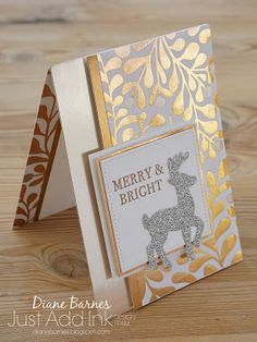 handmade metallic Christmas card using Stampin Up Hearts Come Home stamps, Santa's Sleigh dies, Year of Cheer paper, copper & champagne foil, silver glimmer. Card by Di Barnes colour me happy 2017 holiday catalogue