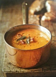 Pumpkin Soup with Sage and Bacon  serves 4      2 T butter  1 onion, finely chopped  1 garlic clove, finely chopped  1 lb. floury white potatoes  2  1/4c of pumpkin flesh, diced  2  3/4c vegetable soup  1c cream, not low fat  2 t freshly grated ginger  1/2 t lemon juice  1 pinch grated nutmeg  salt and freshly ground pepper  4 sliced bacon, diced  5 fresh sage leaves  1 T extra virgin olive oil