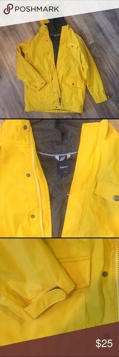 gap classic yellow duck rain jacket Boys XL yellow classic raincoat. Comfy jersey liner. Adjustable closure at wrist. New, never worn. GAP Jackets & Coats